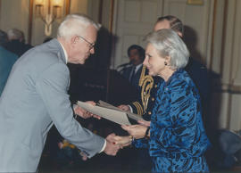 Jeanne Sauvé shakes hands with award recipient