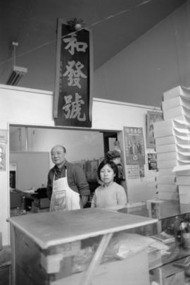 Wo Fat Bakery owner Mr. Wing Chong Yuen and an unidentified woman