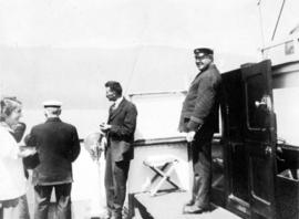 [Captain and others aboard the Camosun]