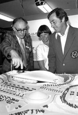 P.N.E. representative E.M. Swangard shows Premier W.R. Bennett and wife scale model of proposed M...