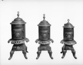 "[Three models of ""Derby Oak"" wood stoves by] Vancouver Stove Maker"