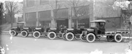 [Cars and trucks in front of Nash Cars and trucks building]