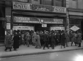 "[Crowd and ""sale"" signs at Share Bros. Ltd. - hardware, 627 Hastings West]"