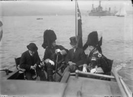 Official in a small boat with members of the Seaforth Highlanders