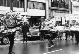 Lion dancers in parade on East Pender Street to protest the construction of a new firehall at Pen...