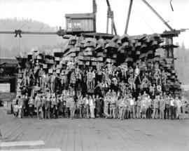 Young Australia League [group posed on lumber stack]