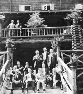 [Civic officials on the steps of the Wigwam Inn]