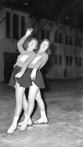 [Two women in figure skating pose, possibly at the Rotary Ice Carnival]