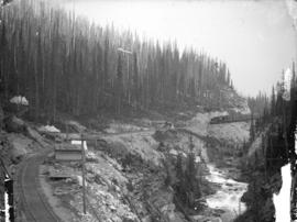 Pacific Express descending western slopes of Rockies along Kicking Horse River, C.P.R.
