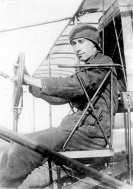"Frank H. Ellis [sitting in his ""Curtis-Type Pusher"" Biplane]"