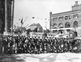 [Longshoremen on Hastings Street in front of their Labour Day parade float replicating the S.S. &...