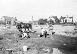 [Men using a horse-drawn plow near Robson Street and Hornby Street to excavate the site for the C...