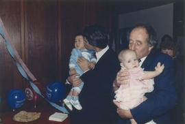 Gordon Campbell and Harry Rankin kissing babies
