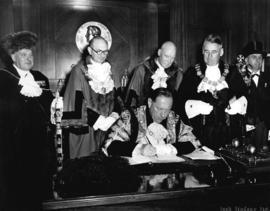 [Sir Denys Colquhoun Flowerdew Lowson, Lord Mayor of London signing the visitors' book in the May...