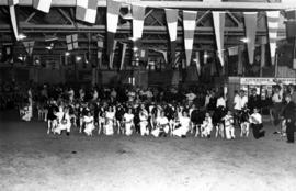 Group photograph of participants in Junior Farmers livestock exhibition in Livestock building