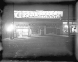 [Illuminated sign for Cascade Beer, located on top of commercial buildings at Granville and Cordo...