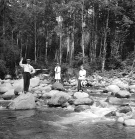 [People standing on rocks in Lynn Creek]