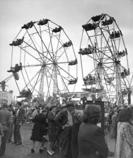Ferris wheels and crowd in P.N.E. Gayway