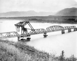 [View from south east of construction of the first Second Narrows Bridge]