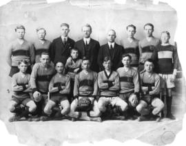 "[Group photograph of  St. John's ""Tigers"" soccer team and coaches]"