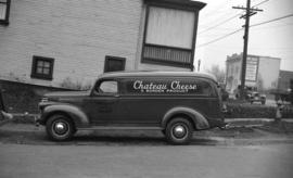 [Ainslie and Co. delivery truck with an advertisement for Chateau Cheese on its side]