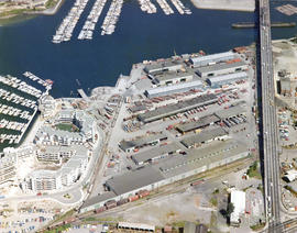 Aerial view of False Creek at Stamp's Landing with Cambie Street Bridge and Heather Civic Ma...