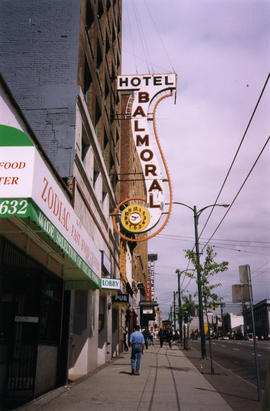 Exterior of the Balmoral Hotel and Zodiac Fast Food Center on East Hastings Street