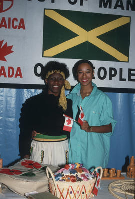 Two women at the Jamaica booth at the Heritage Showcase during the Centennial Commission's C...
