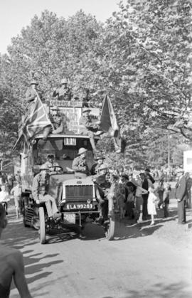 "London omnibus ""Old Bill"" in Vancouver with soldiers and flags"