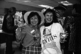 Reva Dexter and unidentified woman indoors at Centennial birthday party