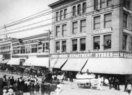 [Laundry company carts on parade at 100 block West Hastings Street]