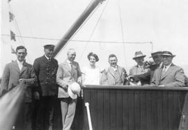 Civic picnic - [Mayor L.D. Taylor and City Hall employees with ship's captain aboard a ship]