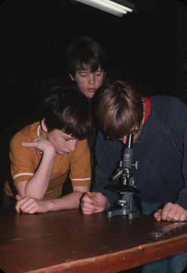 Boys with microscope at Camp Capilano