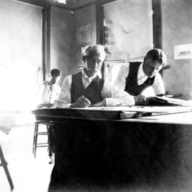 [Osborne J. Pierce at work with colleagues in architect's office]
