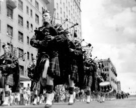 [A Highlander bagpipe and drum band in the Diamond Jubilee Parade]