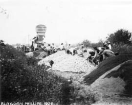 [View of men spreading rocks and gravel during the construction of Macdonald Street]