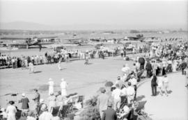 View of airfield [showing crowds at air show]