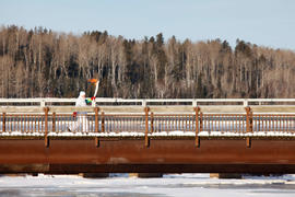 Day 67 Torchbearer 26 J Brad Yeo runs with the flame on the bridge in Kakabeka Falls, Ontario