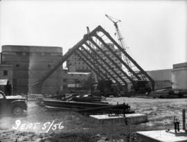 Raw sugar warehouse construction: erecting of A frames for roof