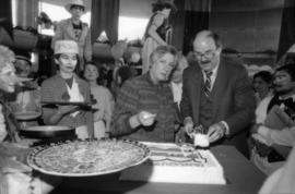Pat Carney and Mike Harcourt serving cake