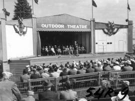 P.N.E. President J.S.C. Moffitt speaking on Outdoor Theatre stage at 1954 P.N.E. opening ceremonies