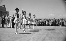 "[Majorettes at head of parade during ceremony to launch the first PBY Catalina ""Athlone&quot..."
