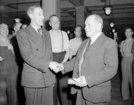 [Two men shaking hands at the opening or completion of the new B.C. Telephone Co. building]