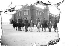 [Northwest Mounted Police on horses in front of stables in Northwest Territories]