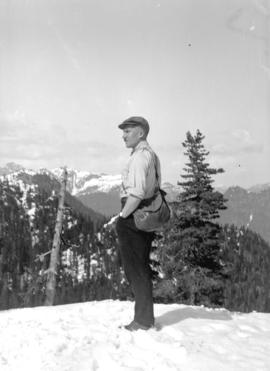 [Man standing in snow on North Shore mountain]