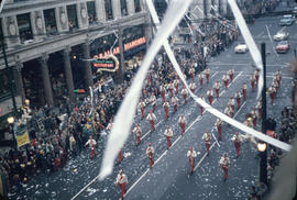 43rd Grey Cup Parade, on Granville Street at West Pender, marching band , ticker tape, spectators...