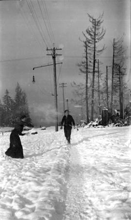 [Couple in snow at 4th Avenue near Waterloo Street]