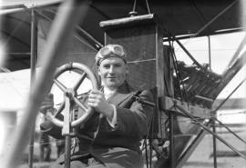 [William McIntosh Stark behind the wheel of a Curtiss School airplane]