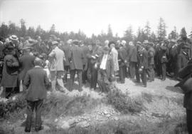 [Group of men gathered to watch the opening of the Saanich Interurban Railway]