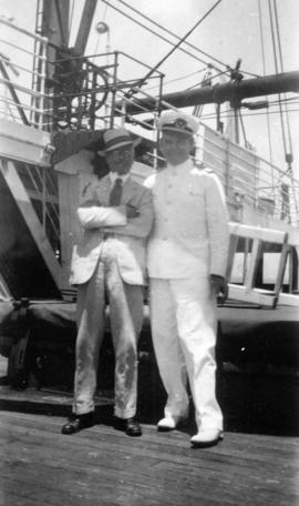 [L.D. Taylor and ship's officer aboard ship]